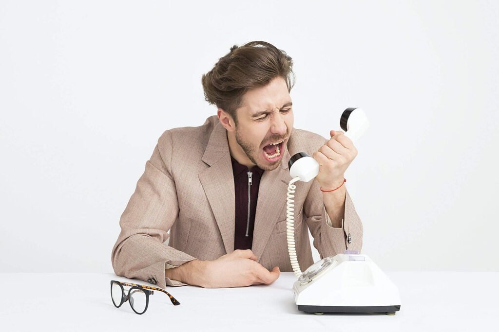 Angry Man Screaming on the Telephone