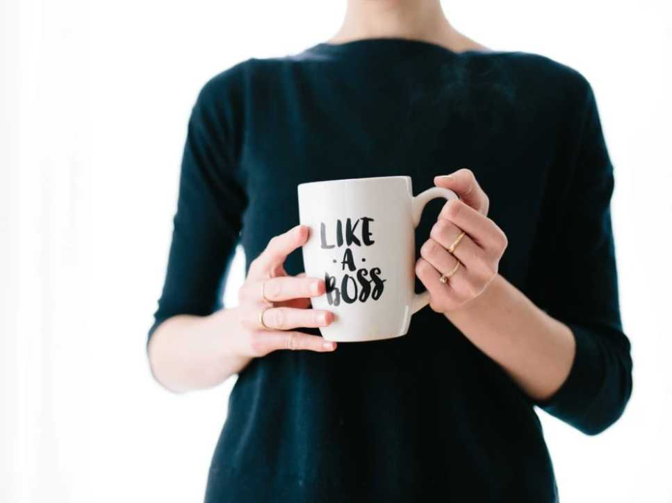 Woman holding a mug with the words like a boss