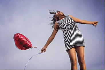 Woman holding a red heart-shaped balloon - paragraphs for her