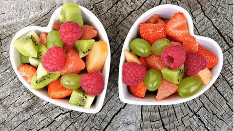 Bowl of mixed fruits in a heart shaped container - paragraphs for her