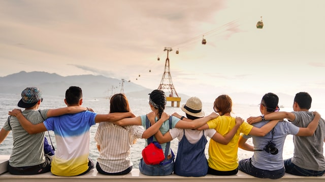 A group of people holding each other while sight seeing