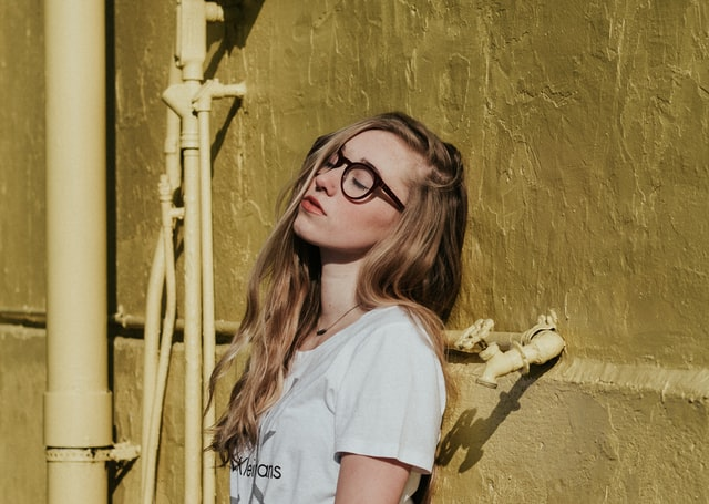 Blonde woman with glasses - Is it bad to be a shy person?