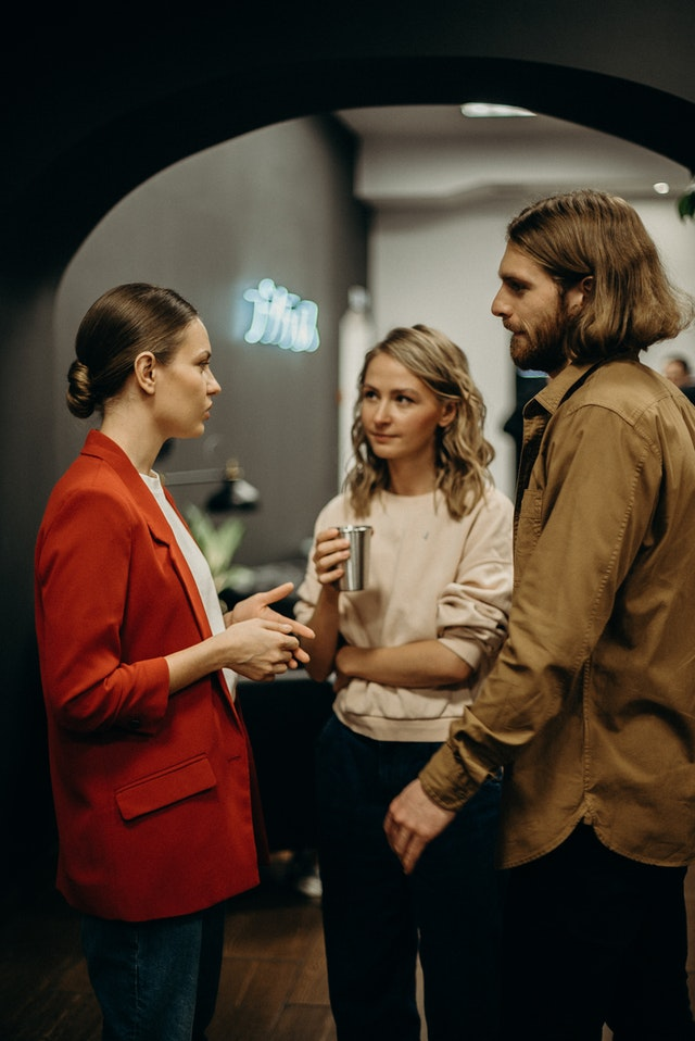 Three people talking to each other - How to improve communication skills