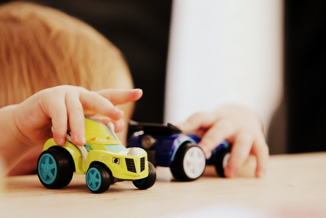 Child playing with two toy cars - Is it bad to be a shy person?